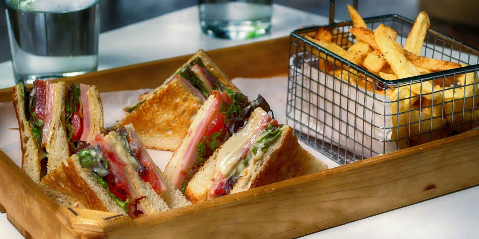 club sandwich and fries in basket