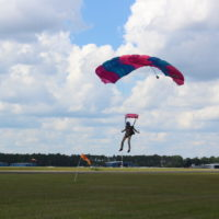 experienced skydiver just about to touch down in landing area
