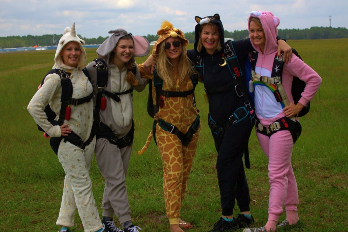 female experienced skydivers hug in animal costumes at World Skydiving Center