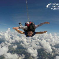 tandem skydiver in freefall with arms outstretched