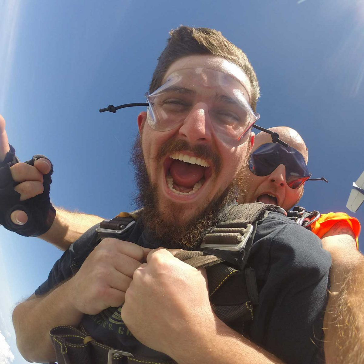young man smiles in freefall skydiving for the first time in Jacksonville FL